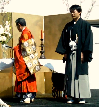 The Groom waits for his bride with the monk officiant...this was a Buddhist ceremony, but most are Shinto.